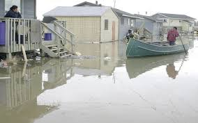 An inept government agent decreed that Kashechewan be relocated to a flood plain west of James Bay. Consequently, residents' homes are flooded every spring.