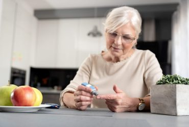 Senior Woman Checking Her Blood Glucose Level