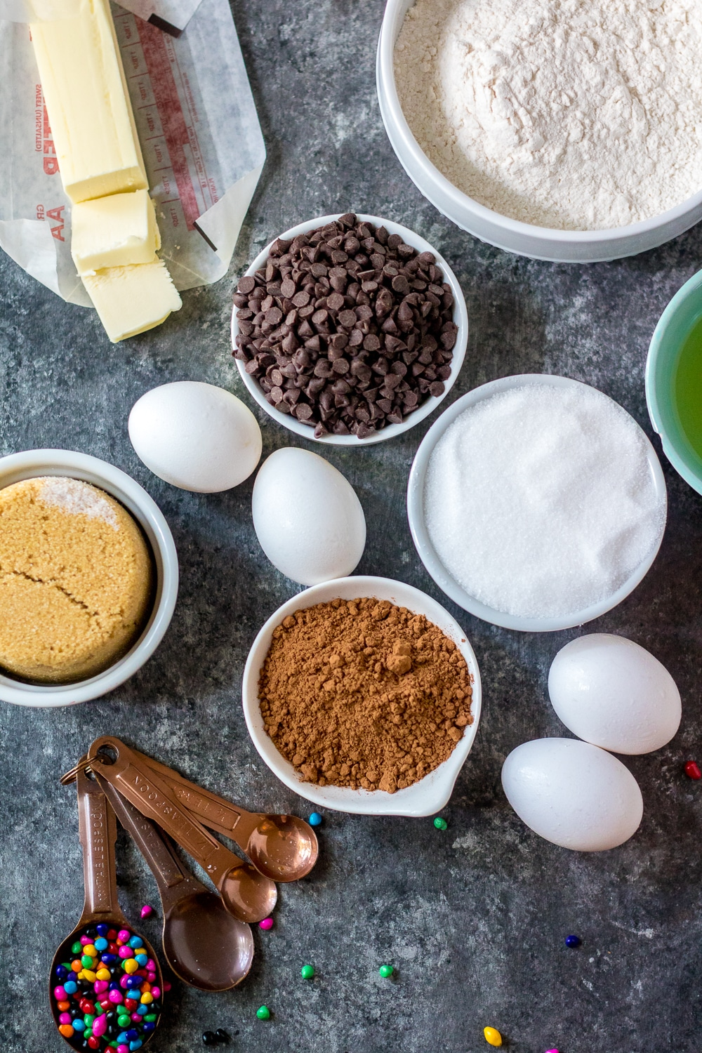 all ingredients for the cosmic brownie recipe on a grey cutting board