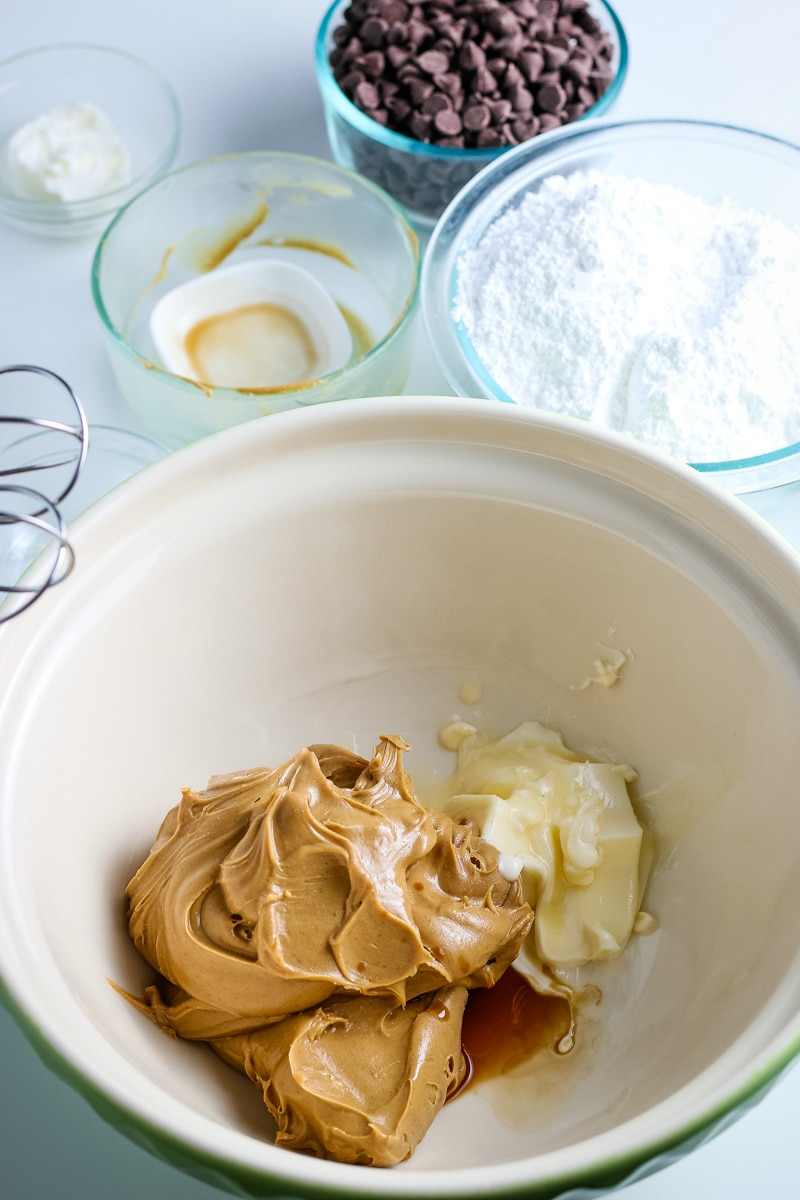 creamy peanut butter and softened unsalted butter in a mixing bowl.