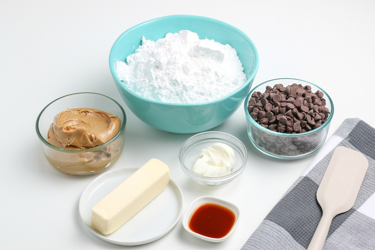 ingredients for chocolate covered peanut butter balls on a white counter top.