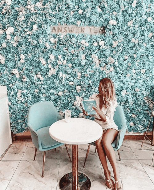 A woman in an Instagrammable cafe