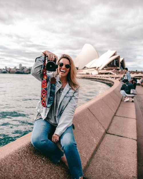 Mel Vandersluis taking photos outside the Sydney Opera House