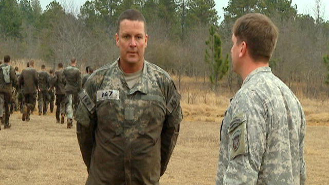 Staff having a 'chat' with US Army SF 'Q' course candidate