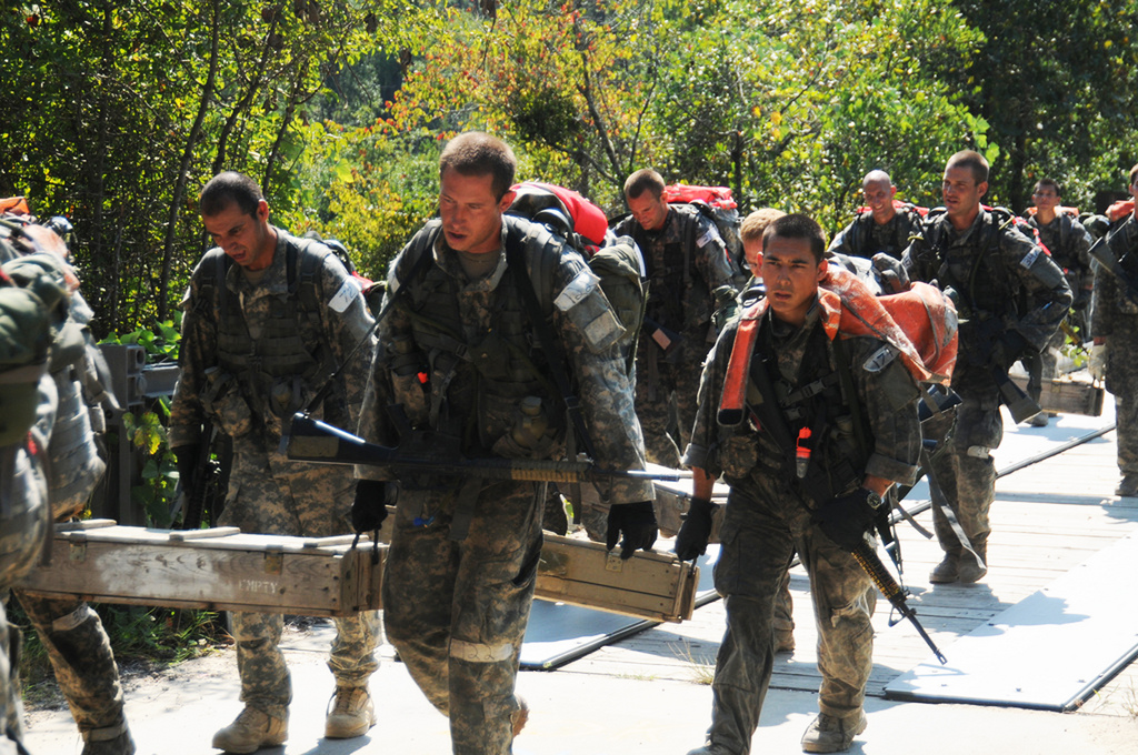 Candidates on the US Army's 'Q' course enjoying their loaded march.