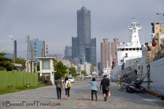 Walking through Pier-2 Arts Center with Kaohsiung in the background