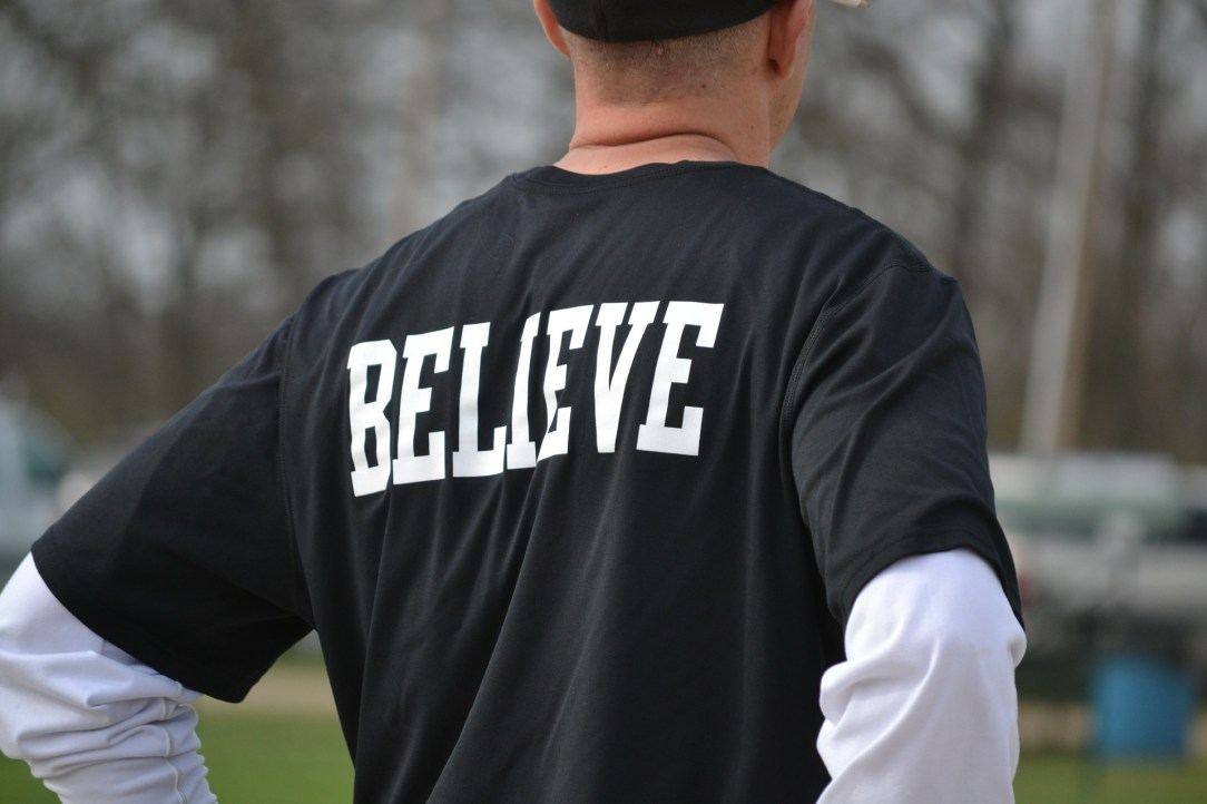 "Person with a shirt saying ""Believe"". Believe that a alcohol free life is possible"