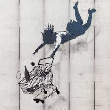 Banksy woman with cart