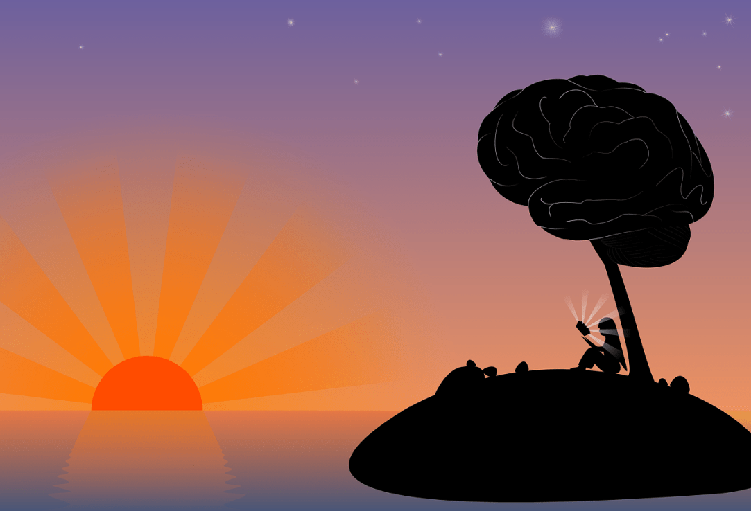 Woman studying under tree on island