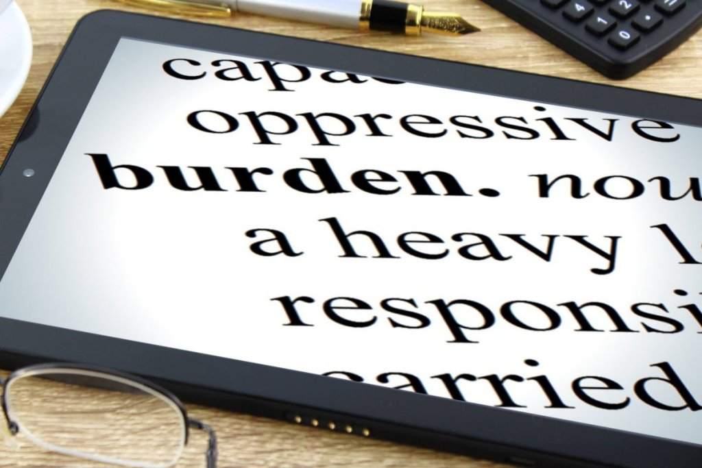 Tablet with words burden heavy Responsibilty -  Representing Burnout in Early Sobriety