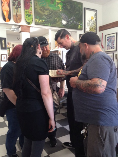 Artist huddle at TattooMania