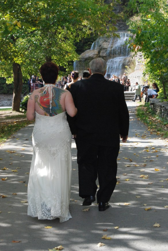 Walking down the aisle, showing my artwork