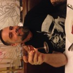 Happy husband with dry rosé and beef tartare in Paris