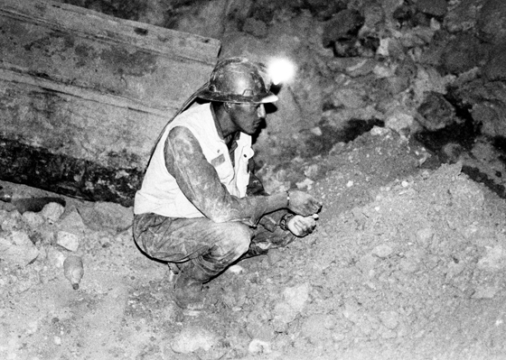 A miner checking the rock