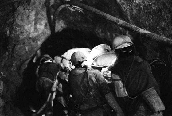 Miners pushing a cart