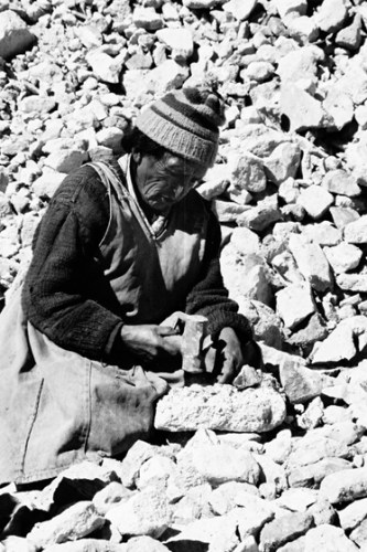 Woman sorting the ore