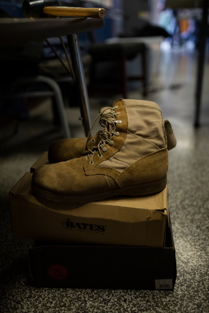 A pair of boots sits in a study hall classroom at the Paul R. Brown Leadership Academy