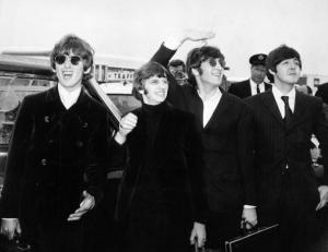 Pop group The Beatles, waving to screaming fans en route to Boston airport, America, from left to right, George Harrison, Ringo Starr, John Lennon and Paul McCartney, on August 12, 1966. (Photo by Daily Express/Archive Photos/Getty Images)