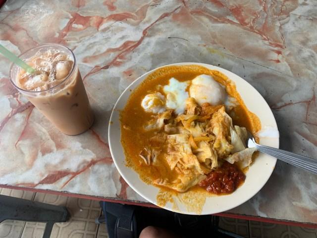 Roti Canai breakfast with Teh Tarik cheap food in Kuala Lumpur