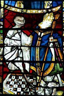 La muerte da jaque mate el obispo - Ventana de cristal pintada en la iglesia de St. Andrew, Norwich. Siglo XV.
