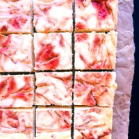 Strawberry Rhubarb Swirled Cheesecake Squares