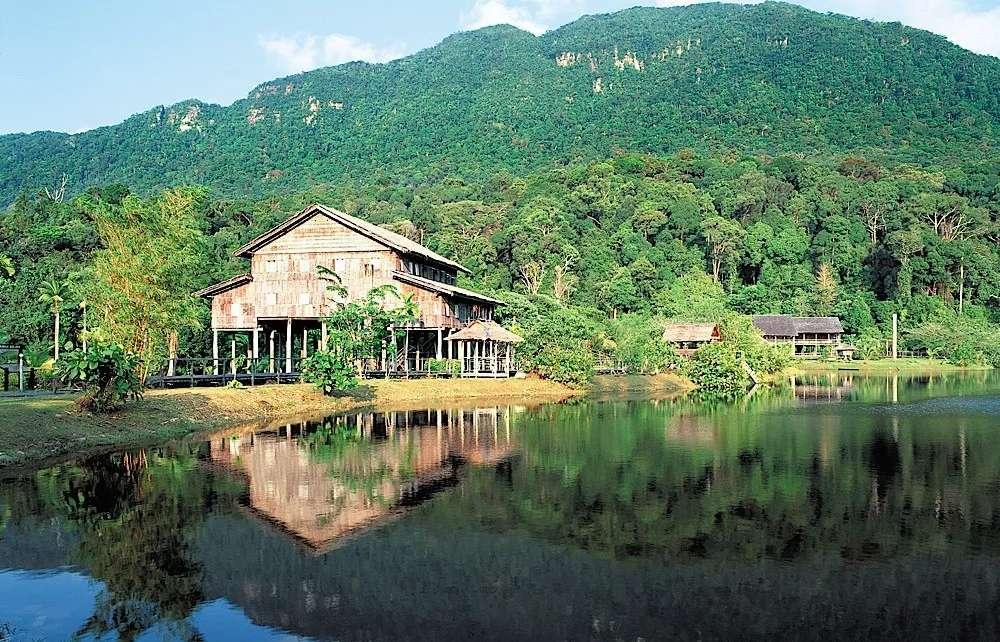 View across the lake to Mount Santubong, Sarawak Cultural Village, Malaysia.