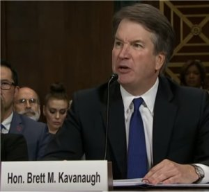 Photo of Brett Kavanaugh looking angry.