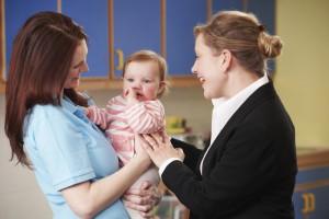 shutterstock_childcareWorker_momandBaby