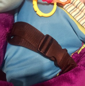 Harness straps to secure the arms around the baby; also doubles to strap around mother for breastfeeding.