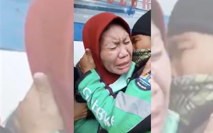 MENANGIS: Seorang ojol perempuan menangis karena lima hari tak dapat orderan. (Foto: SS twitter)