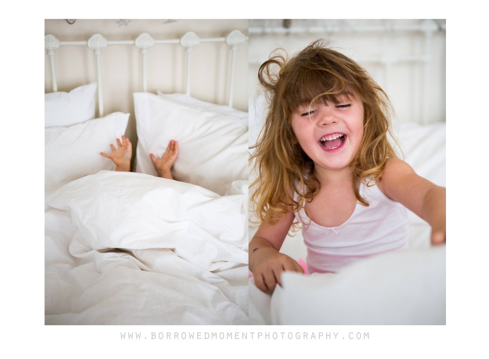 Toddler waking up in bed with a big smile and messy hair