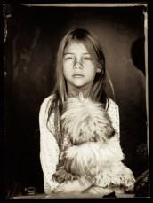 A portrait of my youngest daughter on wet plate collodion negative, illuminated by mighty flash burst. She didn't want to pose for portrait because of the flash burst, but then she change her mind under a threat that there will be no ipad for a week!