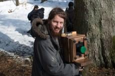 Anže Grabeljšek with homemade walnut camera. Photo Borut Peterlin
