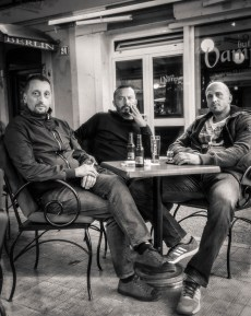 "Portrait taken as a part of a feature reportage about Montenegro in the context of protests and demads of pre-elections. Aleksandar Bulatovic, 43 years old, bartender, Nebojsa Jegric, 42 years, insurance agent and Ivan Nostojic, 37 years, IT expert. ""From this protests nothing good will come up, only problems. Problems will be a lot of them!"" Fourth friend comes by and says ""in case of an emergency I brought a gun with me and the other replies in case of an emergency I brought drugs with me."" They laugh and with loud cheers Živjeli had a drink."