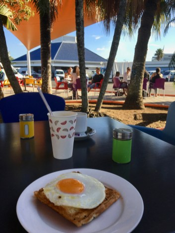 Coffe & a croquet madame at our fresh vegie market, a walk from the marina.