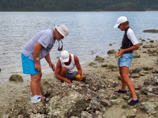 Gathering oysters at Lady Islet in Cid Harbour