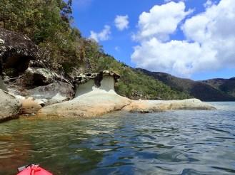 Kayaking around May's Bay ... sculptural rocks that look like waves
