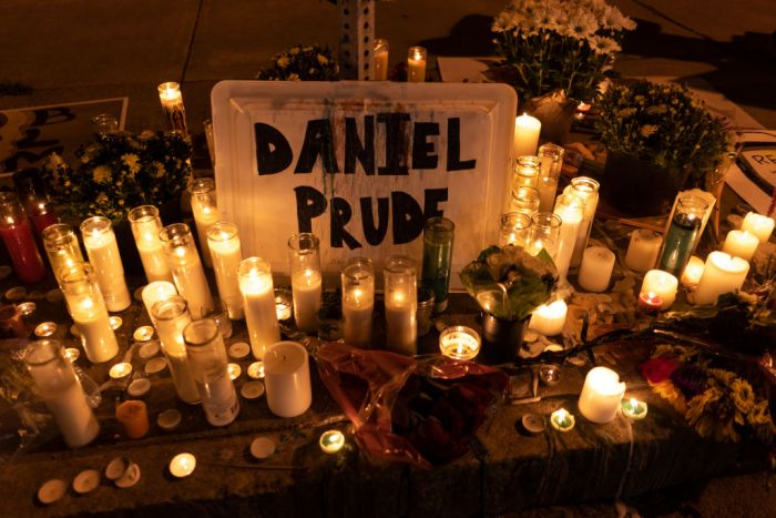 ROCHESTER, NY - SEPTEMBER 3: Candles and flowers are laid out a