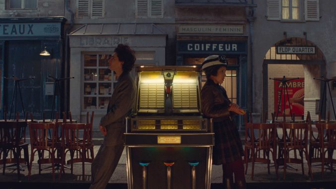Timothée Chalamet and Lyna Khoudri in the film THE FRENCH DISPATCH. Photo Courtesy of Searchlight Pictures. © 2021 20th Century Studios.