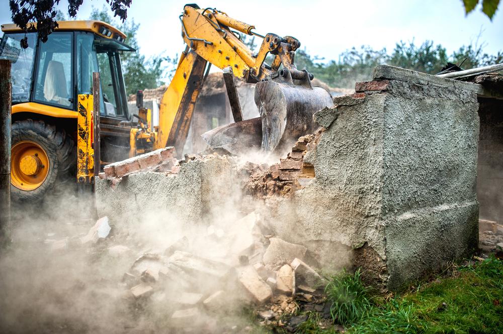 Bulldozer taking down a building