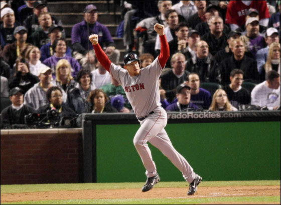 Bobby Kielty No. 32 of the Boston Red Sox watches a solo home run in the eighth inning against the Colorado Rockies during Game Four of the 2007 Major League Baseball World Series at Coors Field on October 28, 2007 in Denver, Colorado.