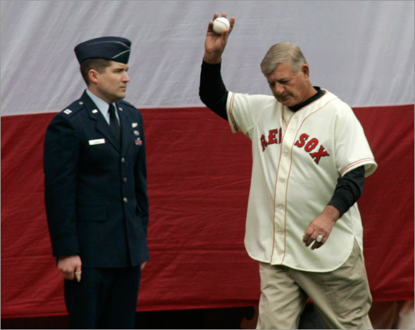 Carl Yastrzemski waved to the crowd as he entered the field on opening day.