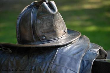 Closeup of the helmet and turnout coat at the Vendome Memorial, 2007.
