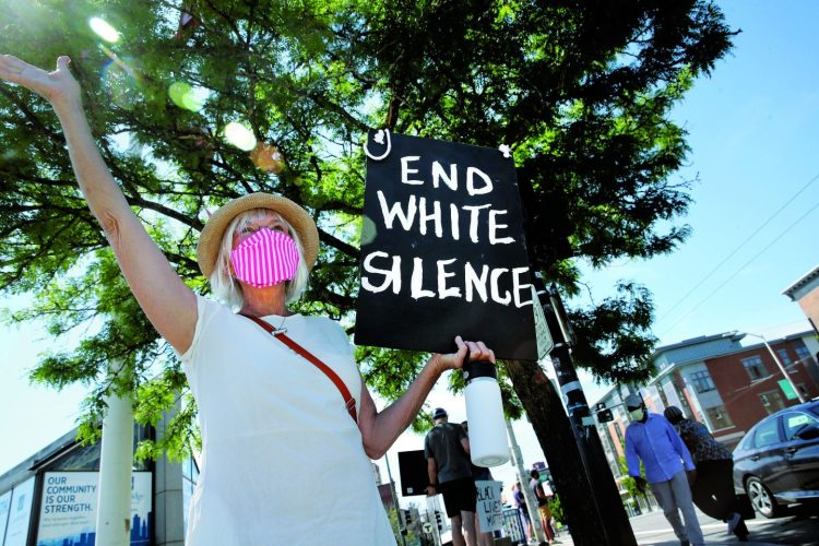 Protests such as this one in Porter Square in Cambridge last weekend have been constant across Massachusetts and have drawn all races.
