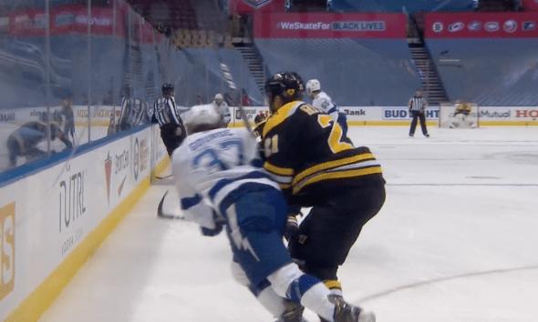 Boston Bruins Nick Ritche hit Yanni Gourde