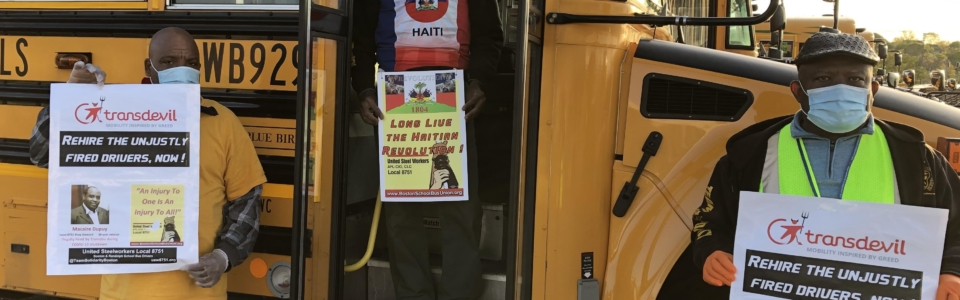 Cadet Floreal Francois at bus with signs 051420