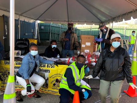 Local 8751 leaders distributing Steelworker-made, American Roots Wear's two-ply, filtered cloth masks and USW-donated face-shields to replace substandard, company-issued, disposable paper at driver route bid, Sept. 23, 2020. Credit: WW Photo: Steve Gillis.