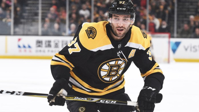 Bruins Captain Patrice Bergeron skates for the puck in a game last season