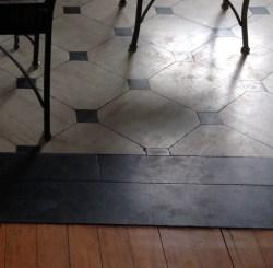 Travertine floor with Black Absolute granite