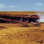 Charcoal burning after clearance of cerrado vegetation